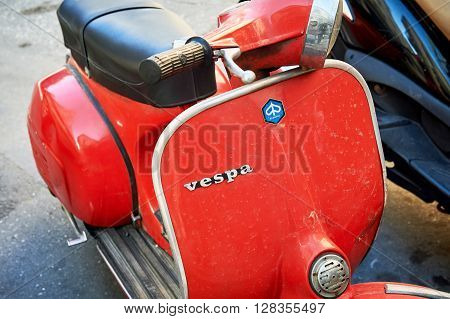 ATHENS GREECE - MAR 29 2016: Old red Vespa Scooter made by Piaggio Motorcycles parked on a street in Athens