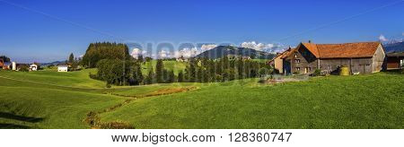 Appenzell landscape and farmhouse by beautiful day, Switzerland