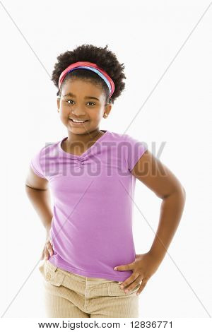 African American girl with hands on hips smiling at viewer.