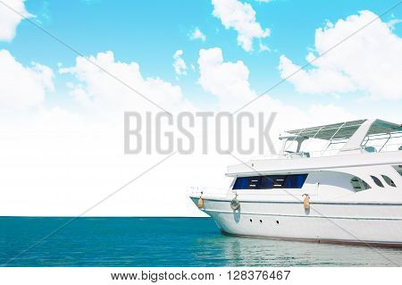 Yatch in beautiful red sea with blue clouds