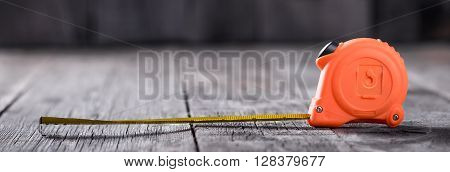 Measuring Tape On A Wooden Board