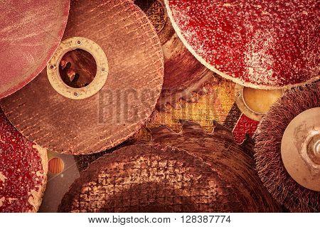 Closeup various abrasive discs hacksaw and circular saw blades pattern. Toned.