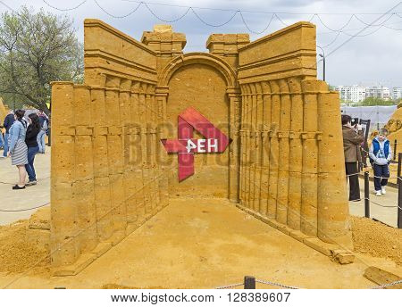 MOSCOW RUSSIA - May 1 2016: A copy of the triumphal arch in Palmyra. Author - Pavel Sokolov. The exhibition contest of sand sculptures in Kolomenskoye Park. The sculpture contains sponsor's logo (Russian TV channel REN TV)