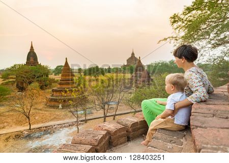 Mother and child are looking sunset from a pagoda in Bagan. Myanmar.