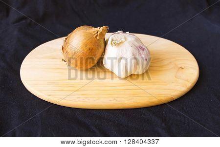 Onions And Garlic On A Chopping Board
