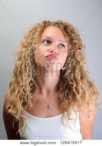 Beautiful Curly Lady Looks Up With Pouting Lips