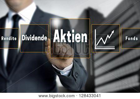 Aktien, Rendite, Dividende, Fonds (in German Shares, Dividend, Return, Fund) Broker With Touchscreen