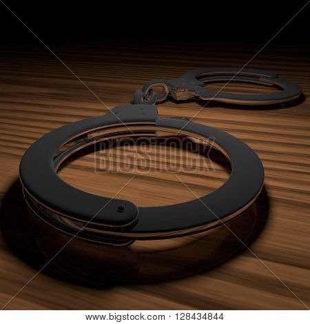 Metal Handcuffs Over Wooden Table