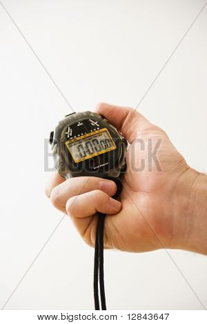 Close-up of adult male hand holding stopwatch.
