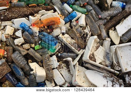 View of polystyrene plastic bottles and other domestic garbage