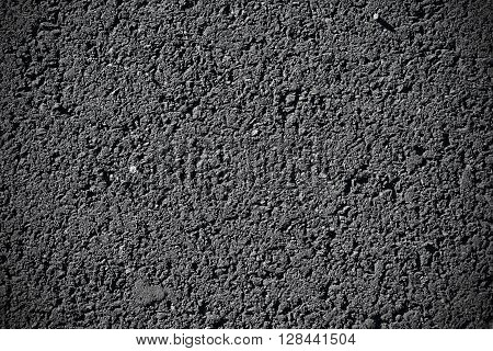 Closeup of black asphalt texture. Pavement background.