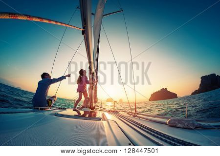 Couple sailing in the tropical sea