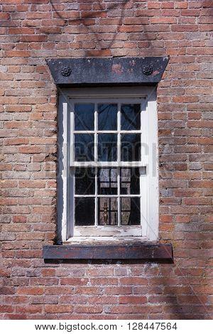 Old Window On Brick House
