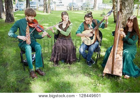 MOSCOW, RUSSIA - MAY 30, 2015: Musical Band Polca an Ri plays music outdoor in forest on summer day.