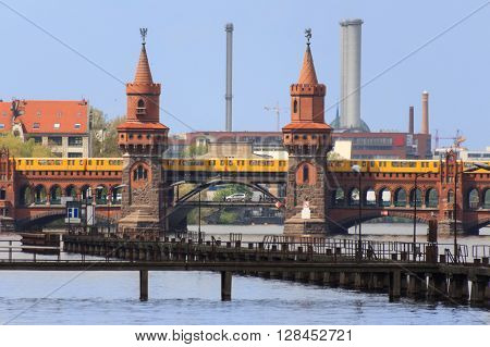 Berlin, Germany - april 30, 2016: Skyline of Berlin showing the Oberbaum bridge (Oberbaumbruecke) over river Spree, a formar border between east- and west-Berlin.