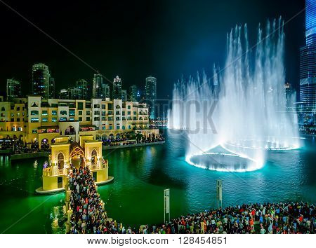 DUBAI, UAE - APR 14, 2013: Beautiful famous downtown fountain area in Dubai at night, Dubai, United Arab Emirates