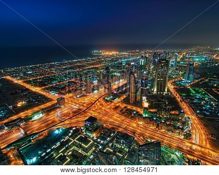 Amazing night skyscrapers at the Sheikh Zayed Road in Dubai, United Arab Emirates
