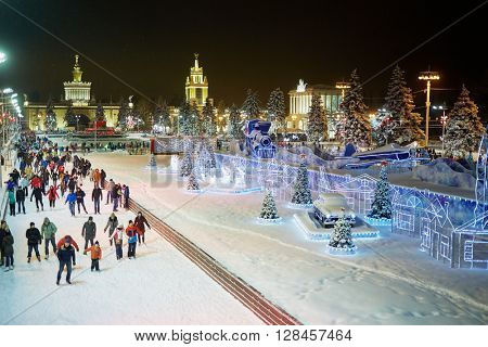 MOSCOW, RUSSIA - JAN 24, 2015: People on scating rink in evening time at VDNKh. Ice skating rink at VDNKh is the largest in Europe - an area more than 20000 square meters.