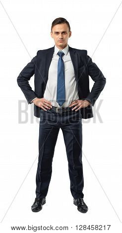 Cutout serious businessman holds his hands on his waist. Self-confidence. Strong commitment. Business staff. Office clothes. Dress code. Presentable appearance.
