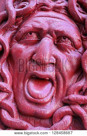 Detail of an old door in Paris representing the gorgon Medusa