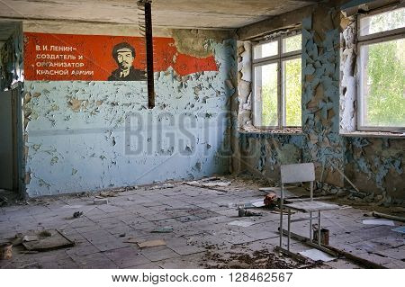 Pripyat, Ukraine - May 9, 2011: Dilapidated soviet propaganda mural in the room of abandoned building in Pripyat town in Chernobyl Exclusion Zone, place of Chernobyl nuclear disaster in Ukraine. Relics from the past still haunt the evacuated town.