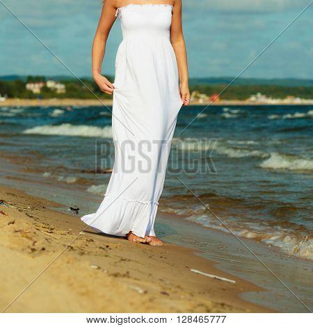 Female Tourist Walking On Beach.