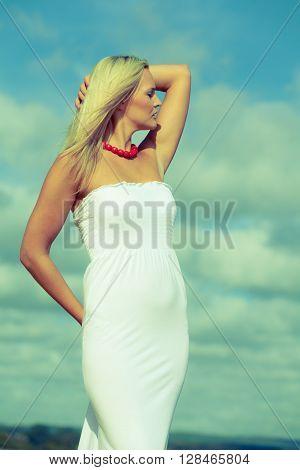 Beauty Blonde Woman Portrait On Sky Background.
