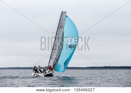 KYIV, UKRAINE - APRIL 26, 2016: Traning on the new model of yacht OceanTECH L30 on the Kyiv water reservoir or Kyiv SEA with Rodion Luka, L30 idea author, Silver medalist.