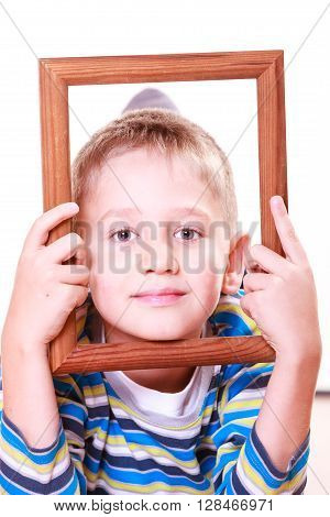 Little Boy Play With Empty Frame.