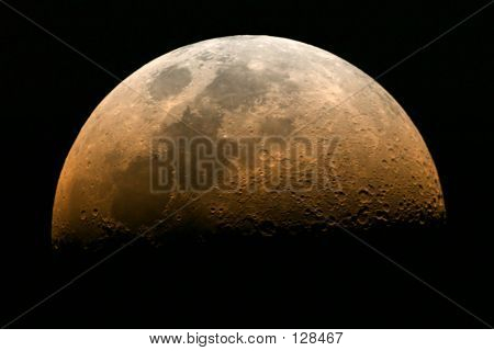 rising moon in its half moon phase with reddish color poster