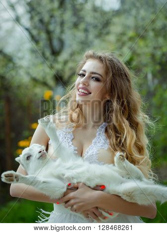 Smiling Woman With Goat