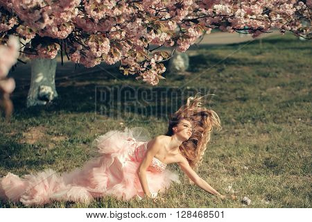 Sensual Woman On Grass With Bloom
