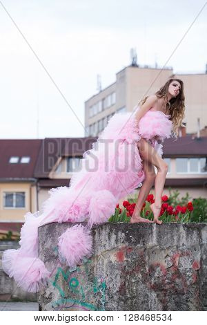 Fashionable Woman Near Red Tulips