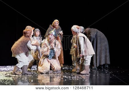 MOSCOW, RUSSIA - JAN 15, 2015: Group of children and God fool on square in front od Cathedral on stage of Moscow theatre Et Cetera in play Boris Godunov directed by Peter Stein.