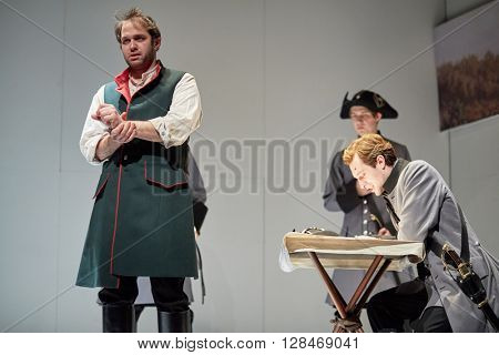 MOSCOW, RUSSIA - JAN 15, 2015: Actors K.Loskutov and S.Davydov as prisoner Rozhnov and Pretender on stage of Moscow theatre Et Cetera in play Boris Godunov directed by Peter Stein.