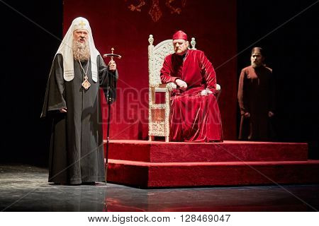 MOSCOW, RUSSIA - JAN 15, 2015: Tzar Boris  on throne and Patriarch on stage of Moscow theatre Et Cetera in play Boris Godunov directed by Peter Stein.