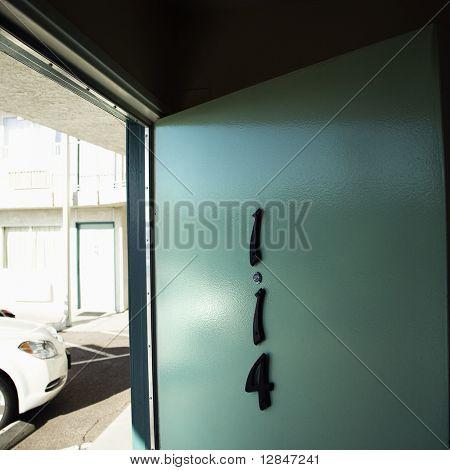 Motel room door on first floor that has been left open.