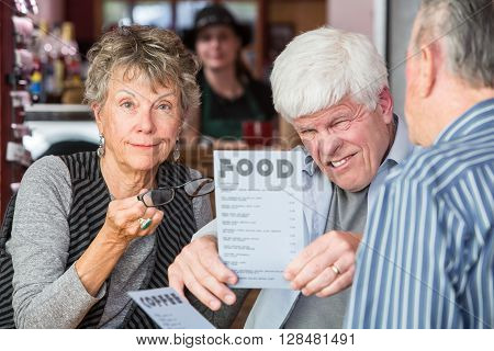 Mature Man Trying To Read Menu Without Glasses
