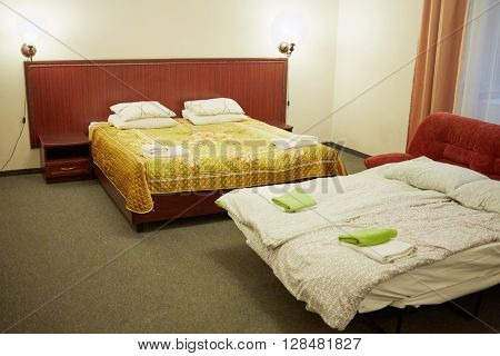Interior of modern room with two double-bed in hotel.