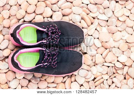 Running shoes in home garden on pebbles, stock photo