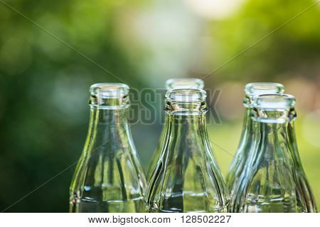 Glass Bottles Over The Sunny Background