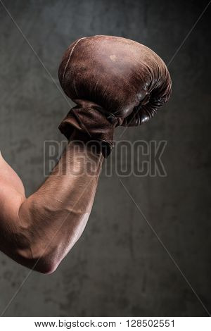 Tough Caucasian Male's Hand In Old Vintage Boxing Gloves, Ready To Fight