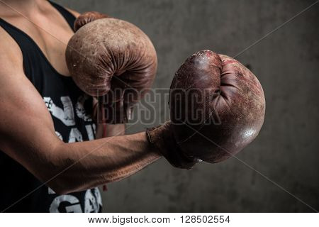 Tough Caucasian Male In Old Vintage Boxing Gloves, Ready To Fight