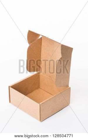 Opened Brown Cardboard Box On A White Background