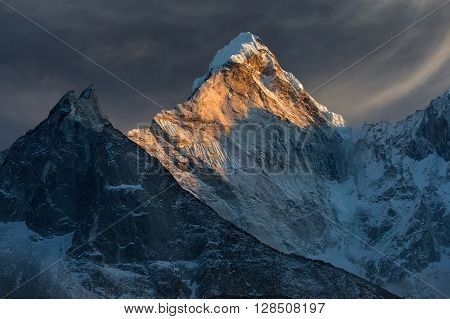 Majestic snowy mountain peak - Ama Dablam (6812 m) is a one of the most beautiful and impressive peaks of our planet.