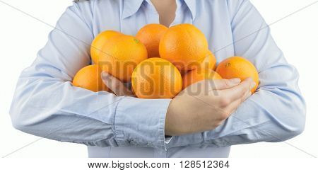 woman holding in her arms citric fruits like oranges with white background