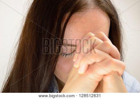 closeup business woman praying to god hop