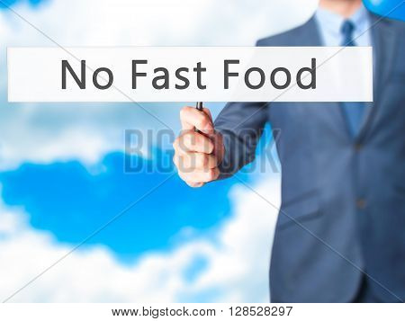 No Fast Food - Businessman Hand Holding Sign