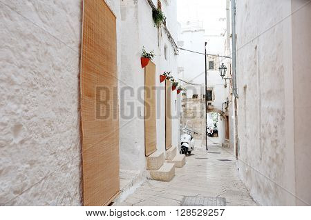 alleyway in medieval city of Ostuni Apulia southern Italy