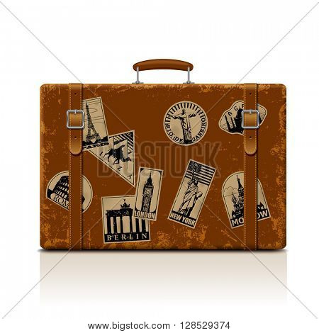 Vintage brown threadbare suitcase with collection of retro grunge vacation & travel labels. Contain the Clipping Path